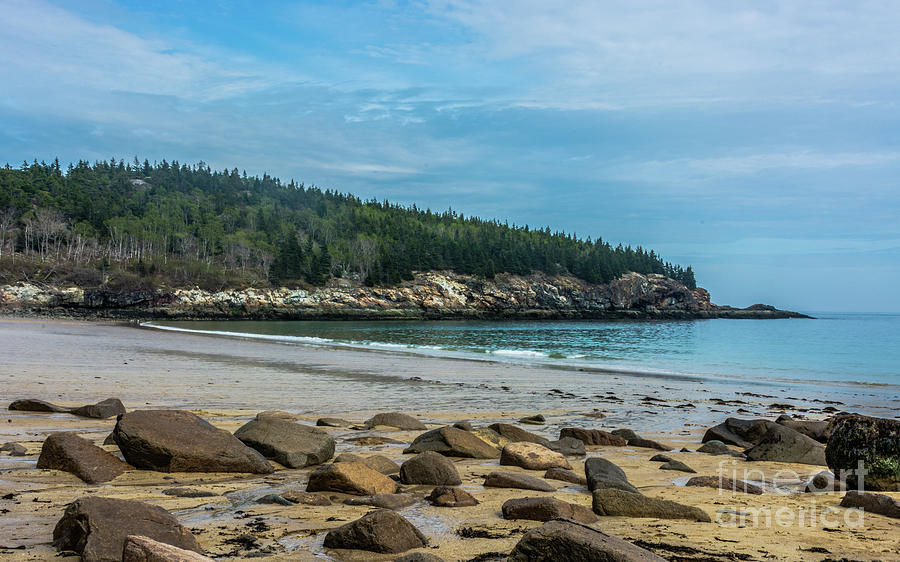 Rock Cover Maine beach with blue sky above by Daniel Ryan