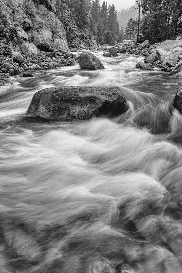 Rocky Mountain Streaming In Black And White Photograph