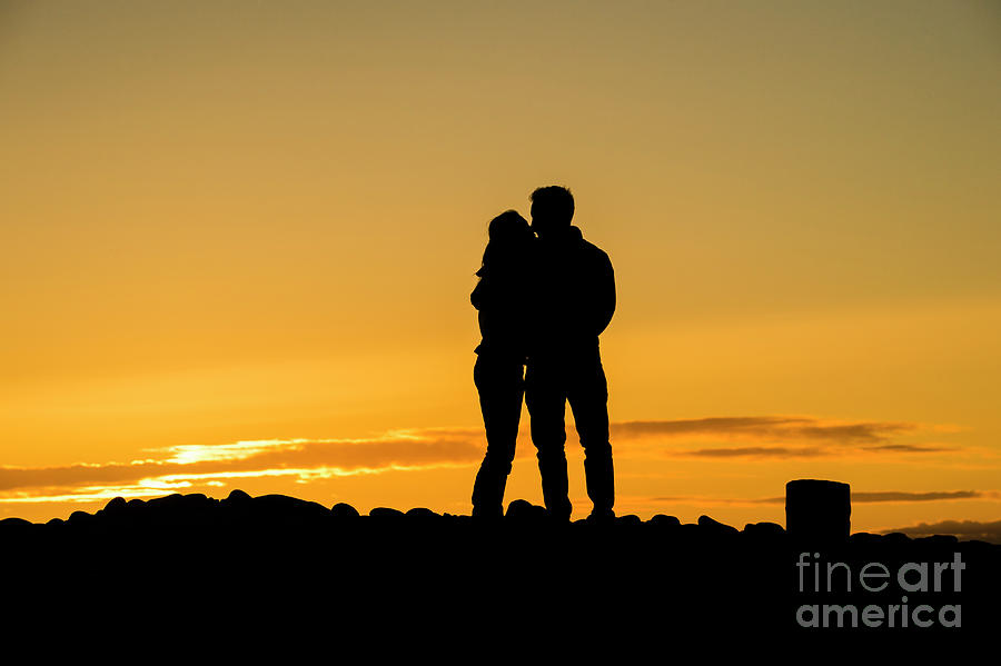 Summer Photograph - Romantic Young Couple Embracing At Sunset by Keith Morris