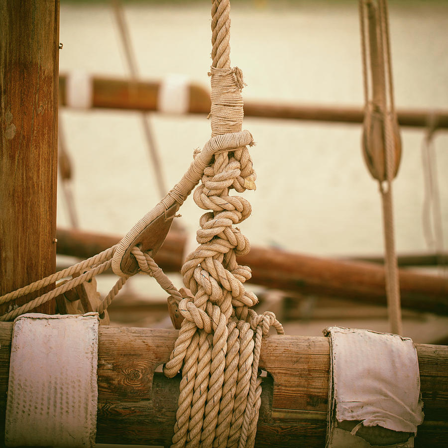 Ropes and lashings on a sailing boat by Paul Cowan