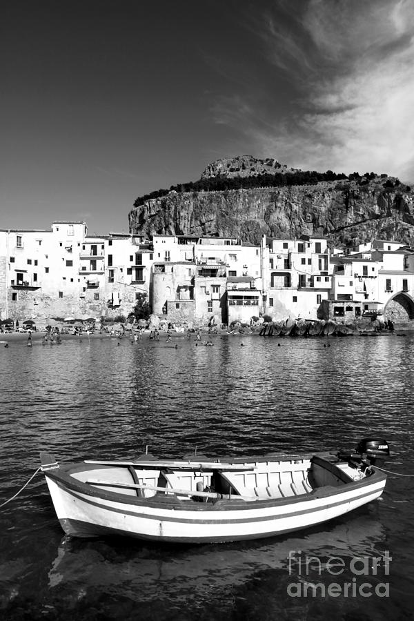 Fishing Boat Photograph - Rowboat Along An Idyllic Sicilian Village. by Stefano Senise