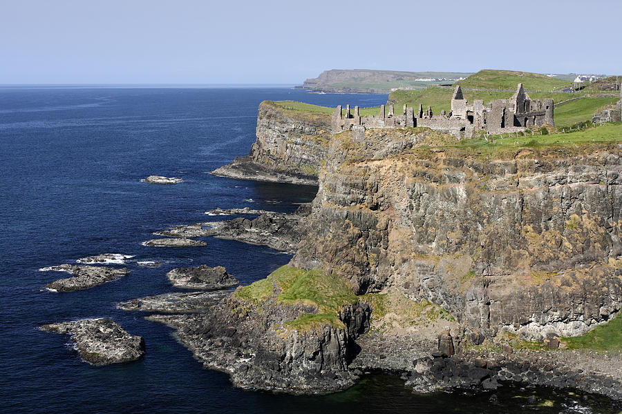 Castle Photograph - Ruins Of Dunluce Castle On The Sea Cliffs Of Northern Ireland by Pierre Leclerc Photography