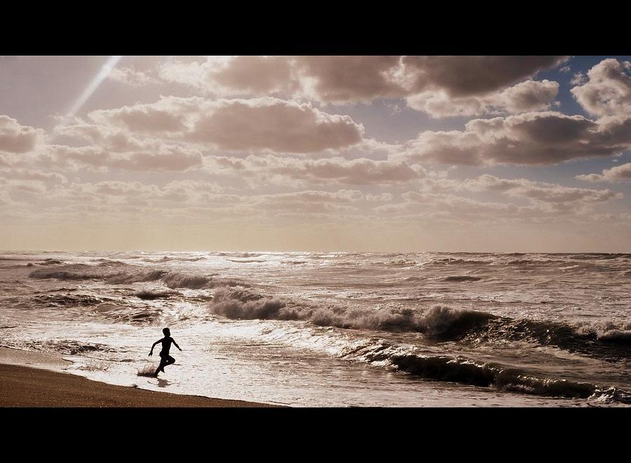 Beach Photograph - Run, You Are Free by Riad Belhimer