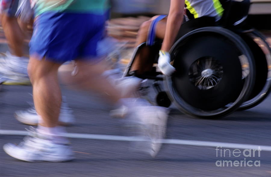 Adult Photograph - Runners And Disabled People In Wheelchairs Racing Together by Sami Sarkis