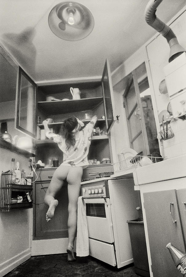 Black And White Photograph - Running Through The Kitchen by Philippe Taka