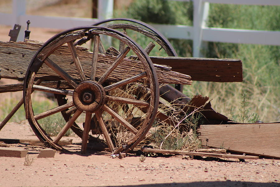 Wooden Photograph - Rustic Wooden Wagon Wheel in Alamogordo New Mexico by Colleen Cornelius