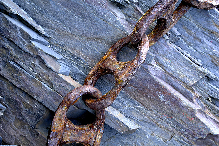 Rusty Chain On The Rocks Photograph by Tom  Wray