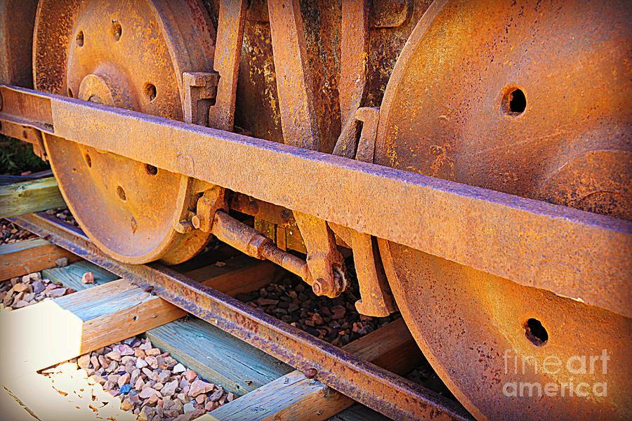 Rust Photograph - Rusty Wheels  by Carol Groenen