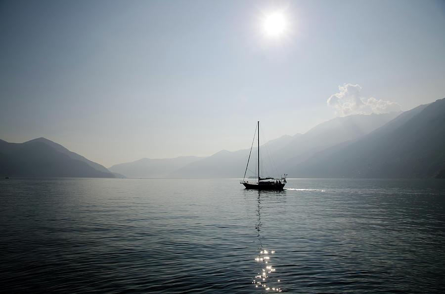 Horizontal Photograph - Sailing Boat In Alpine Lake by Mats Silvan