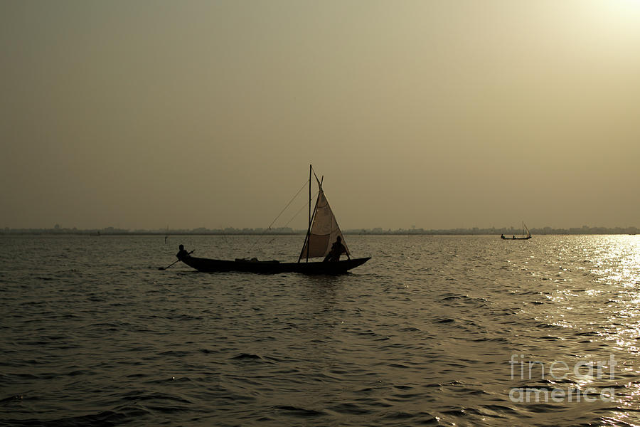 Ganvie Photograph - Sailing Into The Sunset by David Shaffer