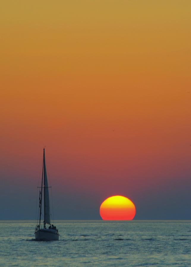 Sailing Photograph - Sailing Off Into The Sunset by Frozen in Time Fine Art Photography