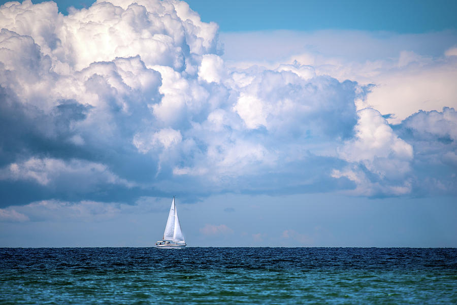 Sailing Under The Clouds Photograph
