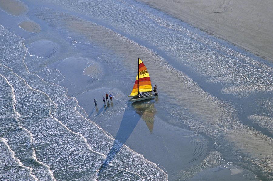 Sailing Photograph - Sailors Take To The Ocean While by Kenneth Garrett