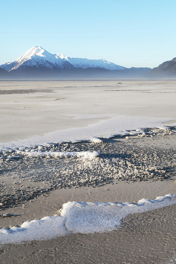 Sand and snow in Southeast Alaska by Michele Cornelius
