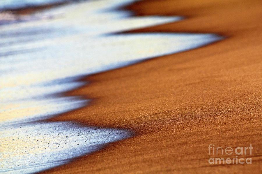 Sand and waves by Tony Cordoza