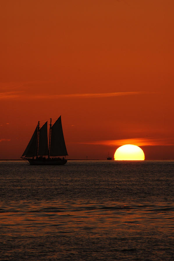Sunset In Key West Photograph - Schooner In Red Sunset by Susanne Van Hulst