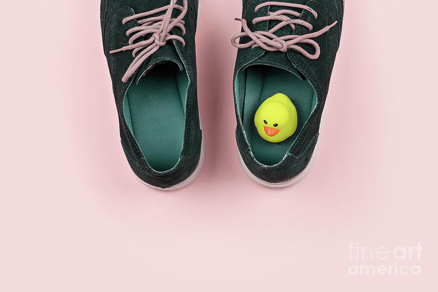 Shoes And Yellow Duck Photograph