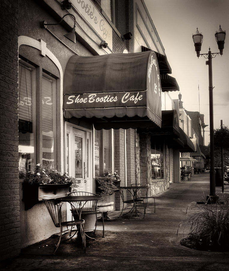 Sidewalk At Shoebooties Cafe In Black And White Photograph by Greg Mimbs