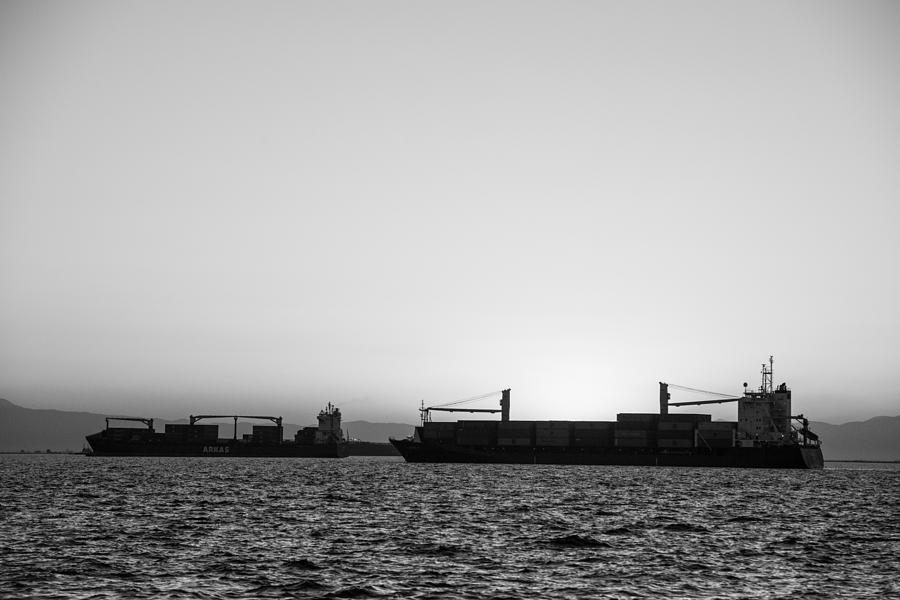 Ship Photograph - Silhouette Of Boats At Sunset by Sotiris Filippou