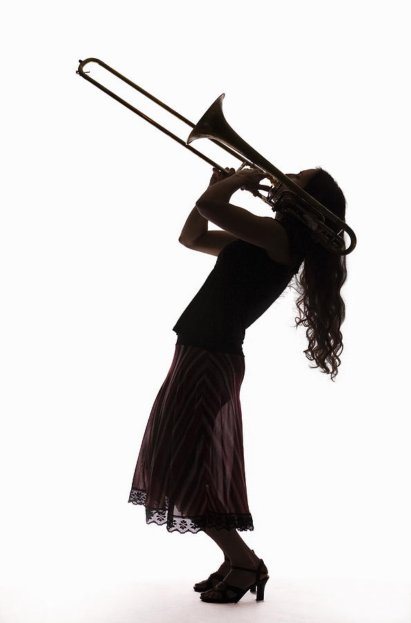 Silhouette Of Female Trombone Player Photograph by PM Images