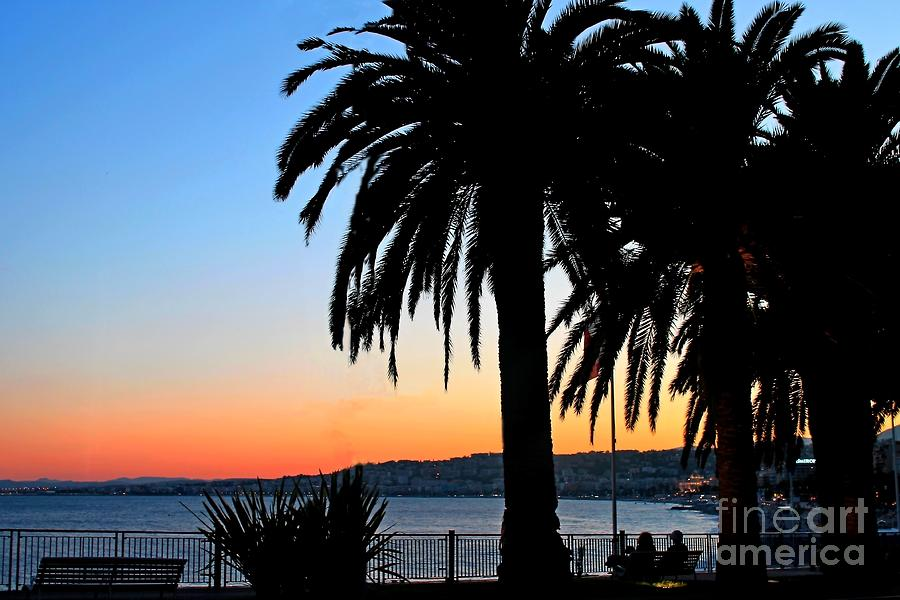 Silhouettes Of A Pair Of People And Palm Trees Against A Beautiful Sunset In Nice France. Photograph