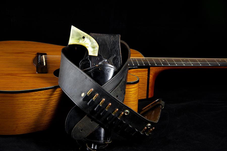 Guitar Photograph - Six Gun And Guitar On Black by M K  Miller