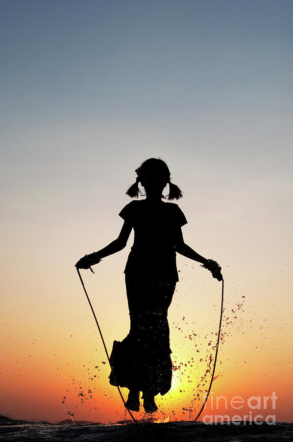 Indian Girl Photograph - Skipping by Tim Gainey