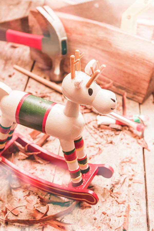 Christmas Photograph - Small Xmas Reindeer On Wood Shavings In Workshop by Jorgo Photography - Wall Art Gallery