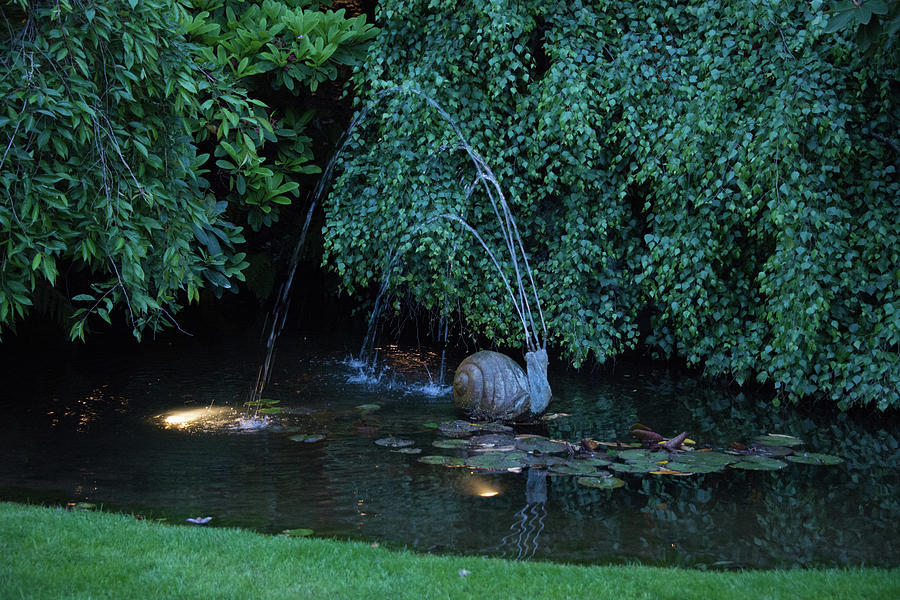 Snail fountain at dusk by Michael Bessler