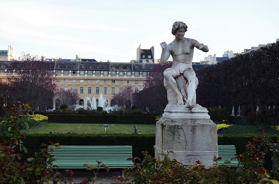 Snake Charmer Statue In The Jardin Du Palais Royal Paris France