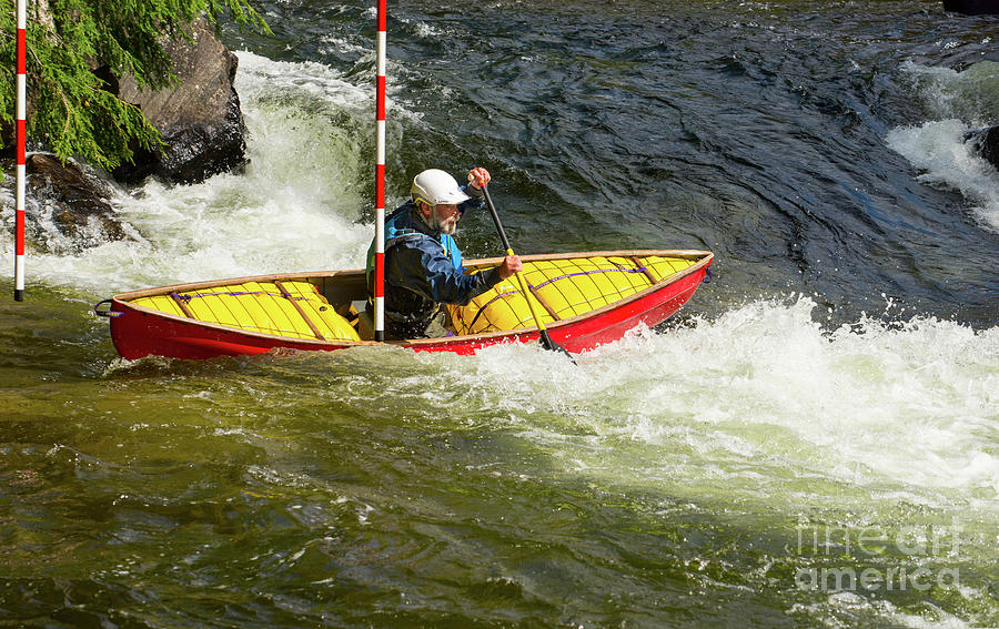 Solo Whitewater Canoe Clearing A Slalom Gate