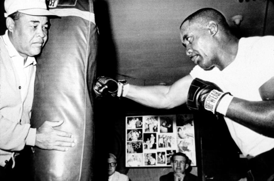 Boxer Photograph - Sonny Liston Working Out On The Heavy by Everett