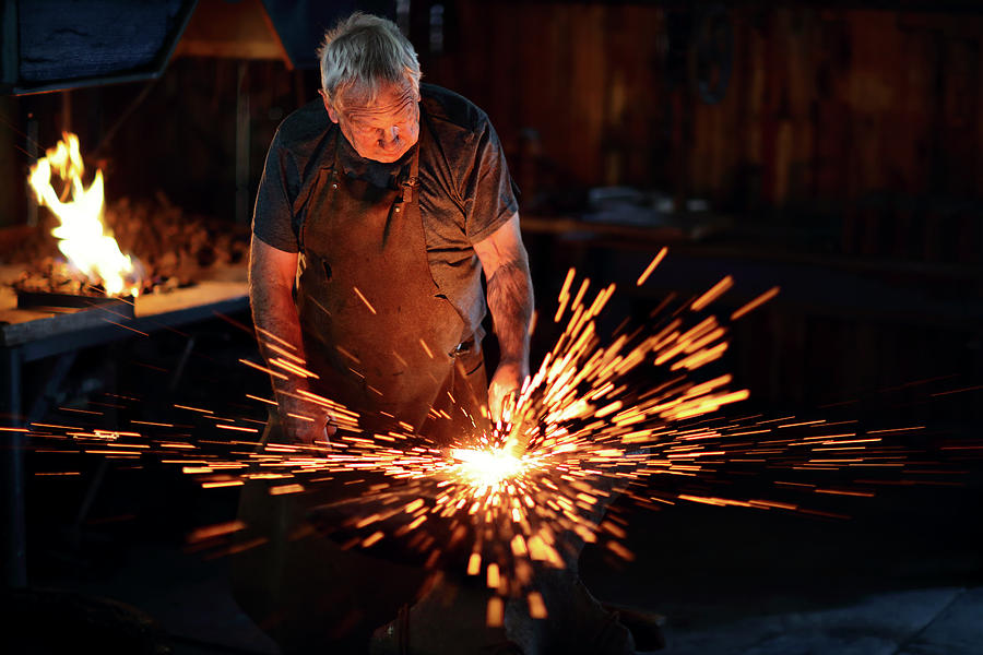 Sparks When Blacksmith Hit Hot Iron Photograph by Johan ...