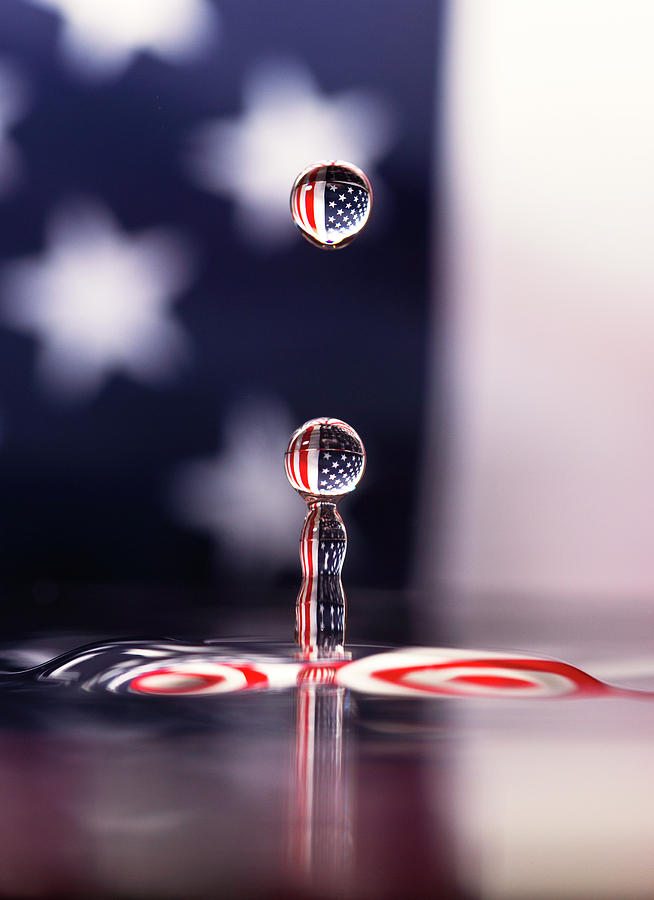 Water Drop Photograph - Stars And Stripes And H20 by Larry Hinson