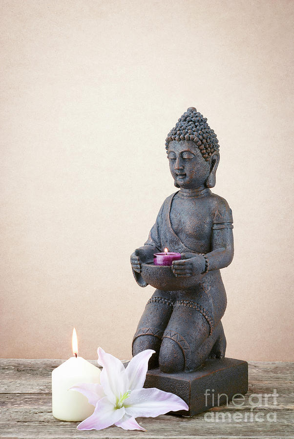 Statue Of Buddha With A Candle His Hand Photograph