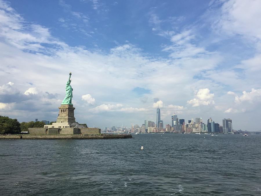 Statue Of Liberty Photograph - Statue Of Liberty And Manhattan View by Olga Kurygina