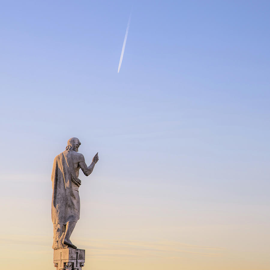Milan Photograph - Statue Pointing To An Airplane Trail by Alexandre Rotenberg