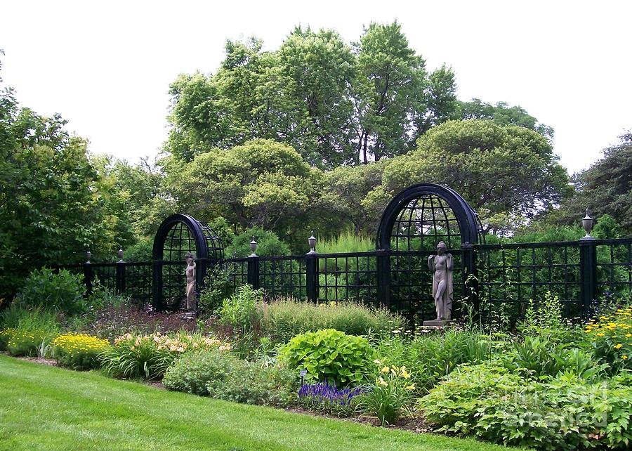 Statues In A Garden Photograph by Laurie Eve Loftin