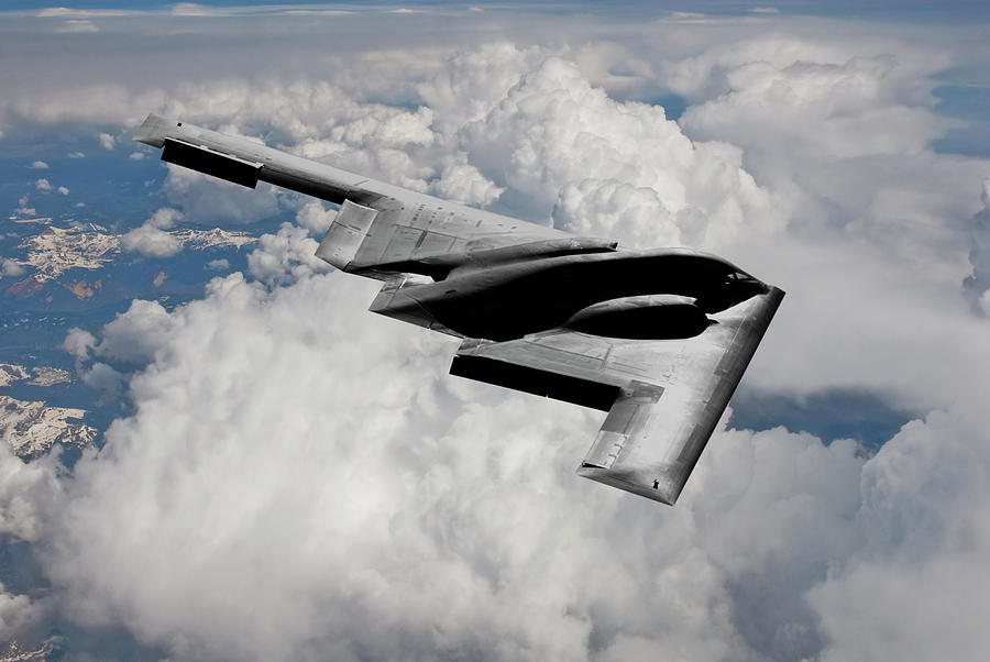B-2 Stealth Bomber Mixed Media - Stealth Bomber Over The Clouds by Erik Simonsen