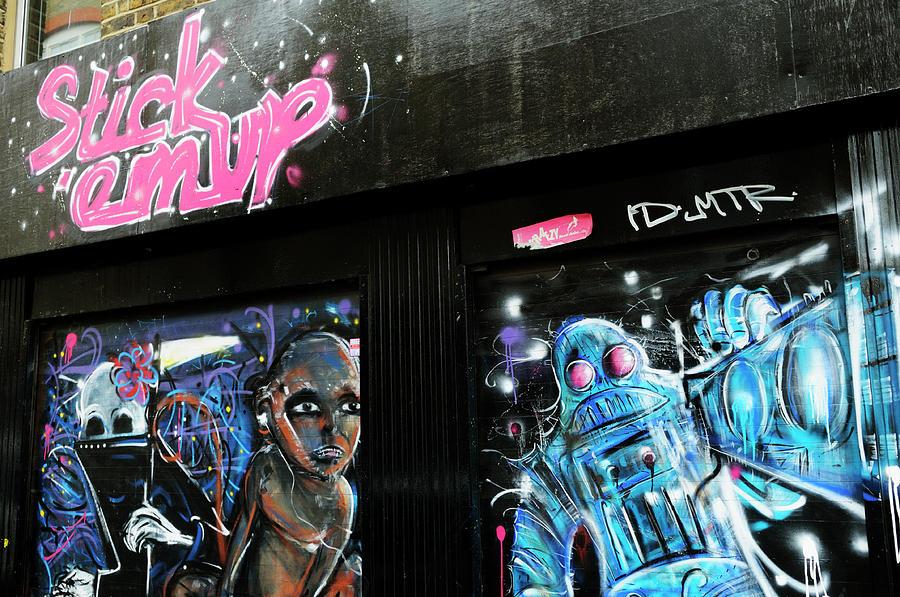 Stick Photograph - Stick em Up Shopfront Graffiti  by Liz Pinchen