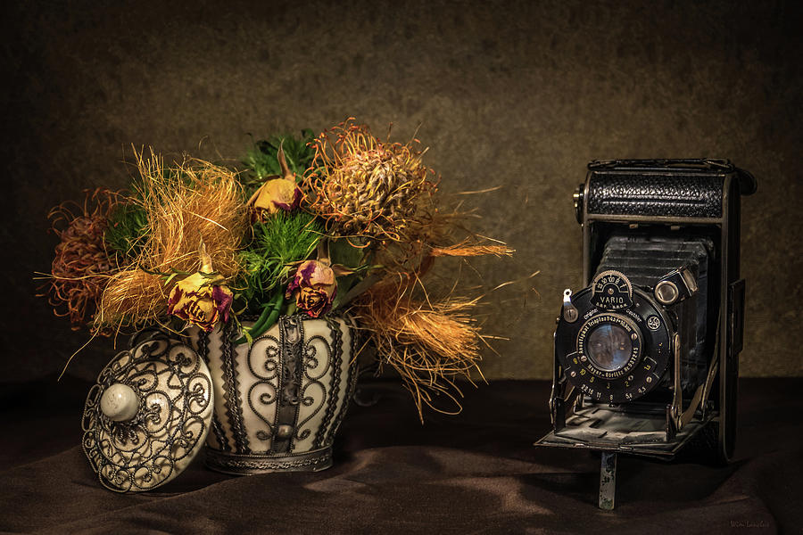 Still Life Photograph - Still Life with Flowers and Camera by Wim Lanclus