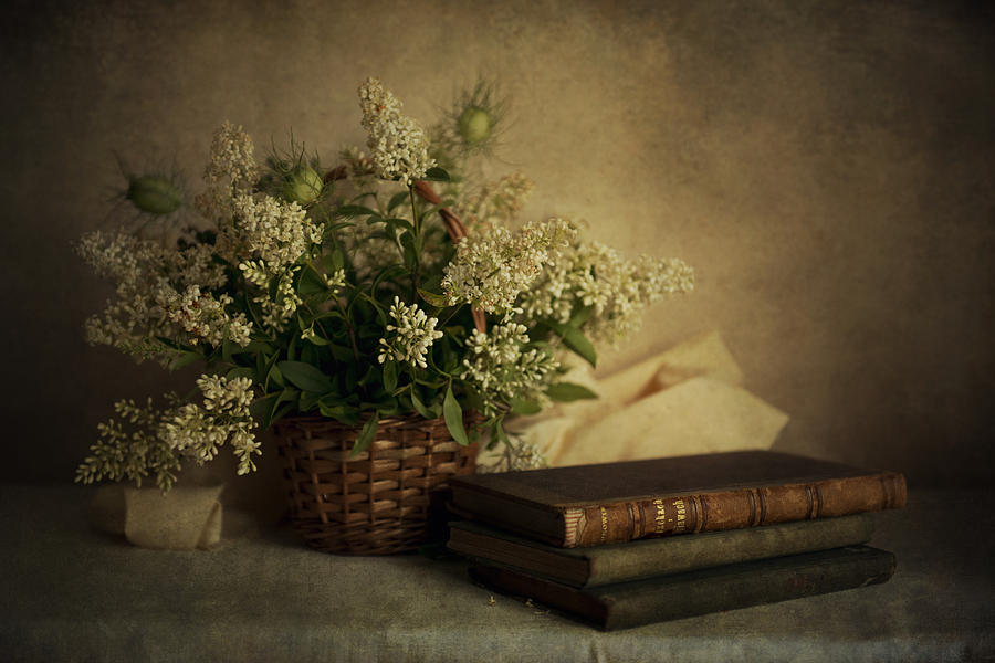 Still Life With Old Books And White Flowers In The Basket