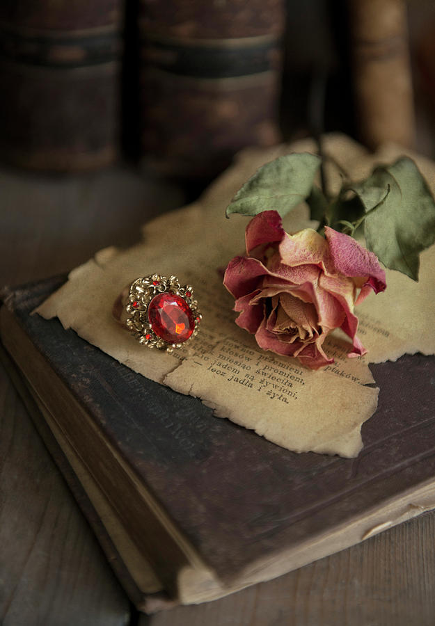 Still Life With Old Books Dried Rose And Big Ring