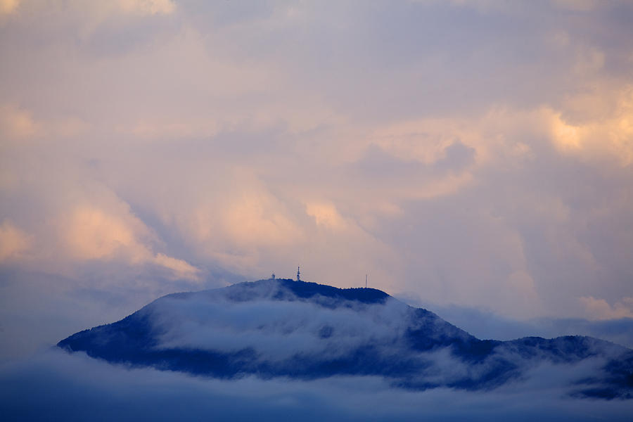 Storm Photograph - Storm Clouds Gather Over Mountains by Ian Middleton