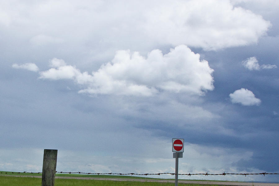 Storm Clouds With Barb Wire Fence And Road Sign Along The Highway In ...