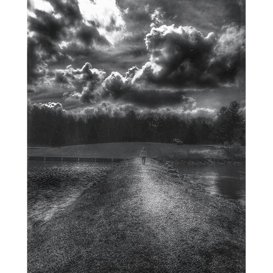 Woman Photograph - A Woman Walking into a Storm  by Phunny Phace