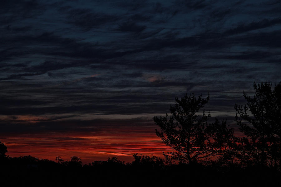 Stormy sunset by Donna Quante