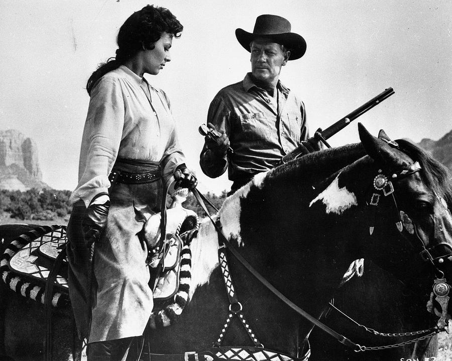 Arizona Photograph - Stranger On Horseback by Bob Bradshaw