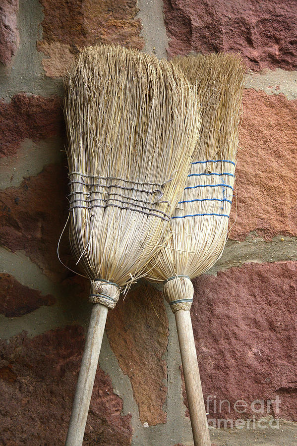 Straw brooms in love by Jan Brons