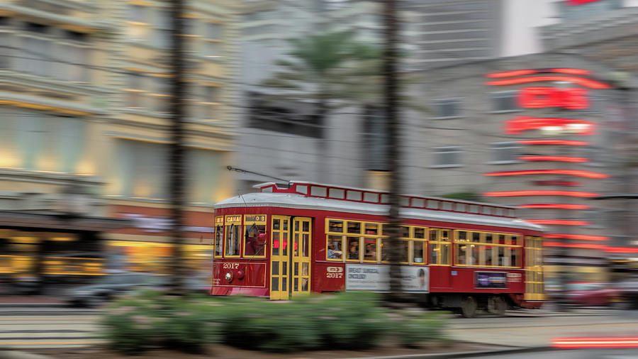 New Orleans Photograph - Street Car Flying Down Canal by Susan Rissi Tregoning